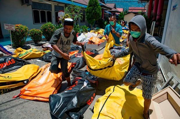 Toàn cảnh công tác cứu hộ trong thảm họa động đất sóng thần ở Indonesia - Ảnh 4.