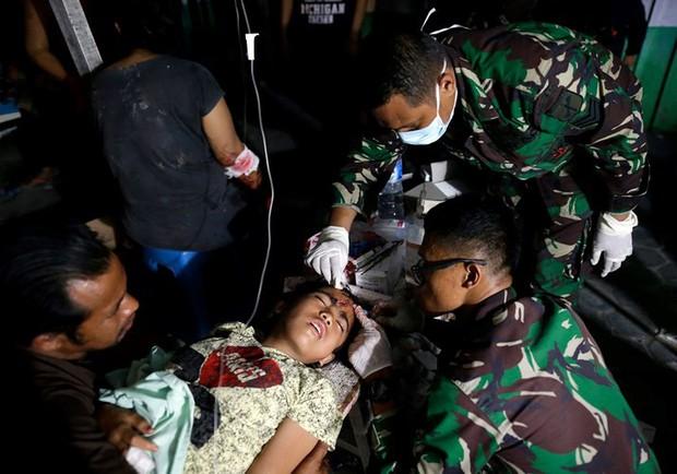Toàn cảnh công tác cứu hộ trong thảm họa động đất sóng thần ở Indonesia - Ảnh 5.