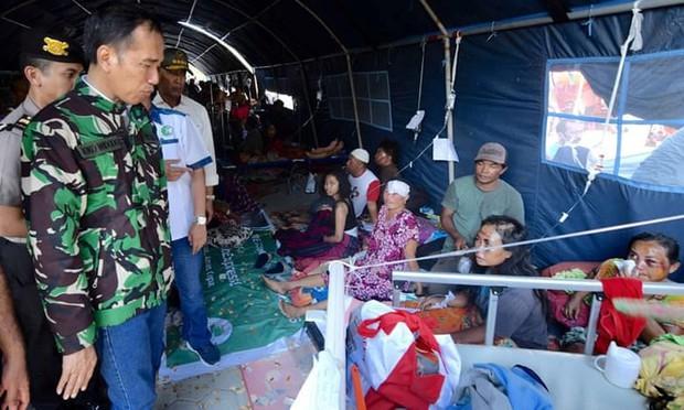 Toàn cảnh công tác cứu hộ trong thảm họa động đất sóng thần ở Indonesia - Ảnh 7.