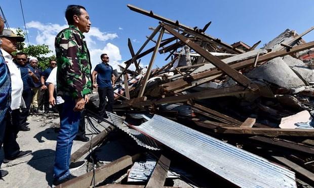Toàn cảnh công tác cứu hộ trong thảm họa động đất sóng thần ở Indonesia - Ảnh 8.