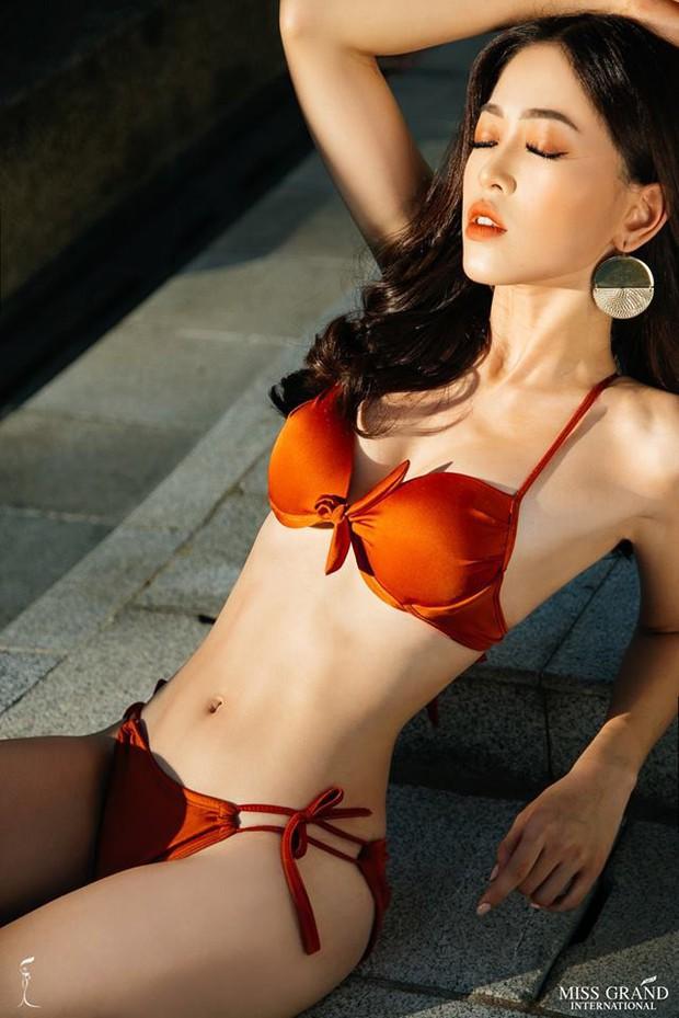 Phương Nga khoe body nóng bỏng, ngồi vị trí trung tâm trong bộ ảnh bikini tại Miss Grand International 2018 - Ảnh 1.