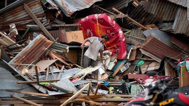 Sau thảm họa động đất, sóng thần, nạn cướp bóc hoành hành ở Indonesia - Ảnh 1.
