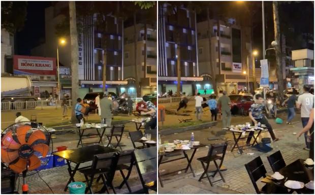 Clip: Nhóm thanh niên cầm bàn ghế của quán nhậu phang nhau ngay giữa đường phố Sài Gòn khiến nhiều người hoảng sợ - Ảnh 2.