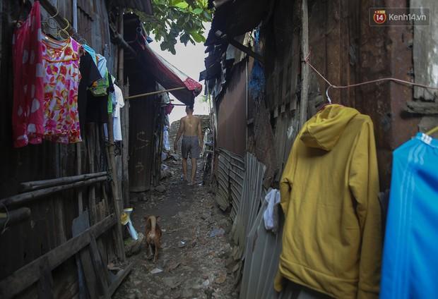 Chùm ảnh: Khu ổ chuột của hơn 15.000 người sống treo trên di sản thế giới ở Kinh thành Huế - Ảnh 4.