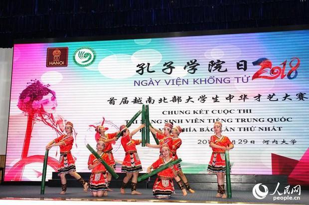 Báo Trung Quốc đồng loạt đưa tin về cuộc thi tài năng sinh viên tiếng Trung tổ chức tại Đại học Hà Nội - Ảnh 4.