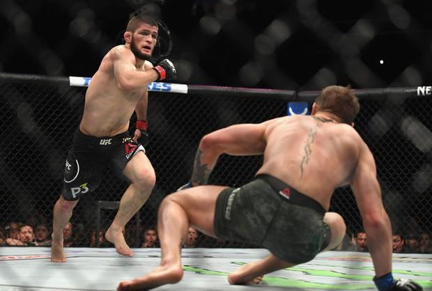 Gã điên McGregor thua đau trong lần tái xuất, tạo ra vụ ẩu đả chưa từng có trong lịch sử UFC - Ảnh 7.