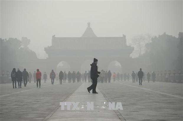 Thủ đô Bắc Kinh ban bố lệnh báo động vàng về ô nhiễm không khí  - Ảnh 1.