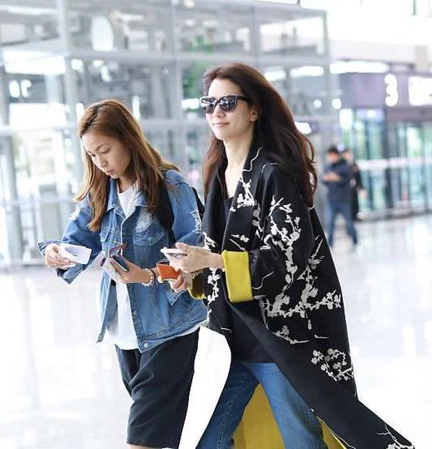 Vợ chồng Viên Vịnh Nghi - Trương Trí Lâm cãi nhau tại sân bay, mặt nặng mày nhẹ cả dọc đường - Ảnh 10.
