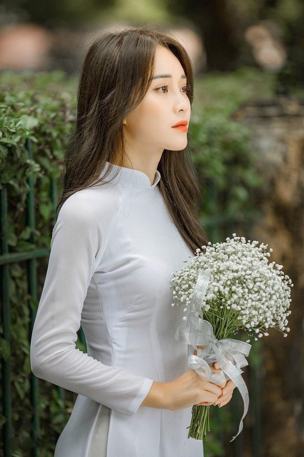 Diện áo dài cực xinh trong bộ ảnh kỷ yếu, Á khôi sinh viên Việt Nam được nhận xét tựa bản sao Nam Em, thần thái còn sang hơn - Ảnh 8.