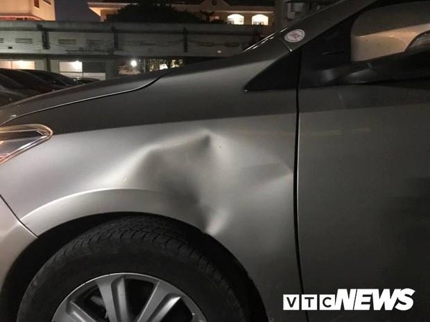 Tài xế côn đồ đánh dã man người bị lùi xe trúng ở TP.HCM - Ảnh 1.