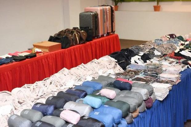 Trộm quần áo, 4 người Việt bị kết án tù tại Singapore - Ảnh 1.