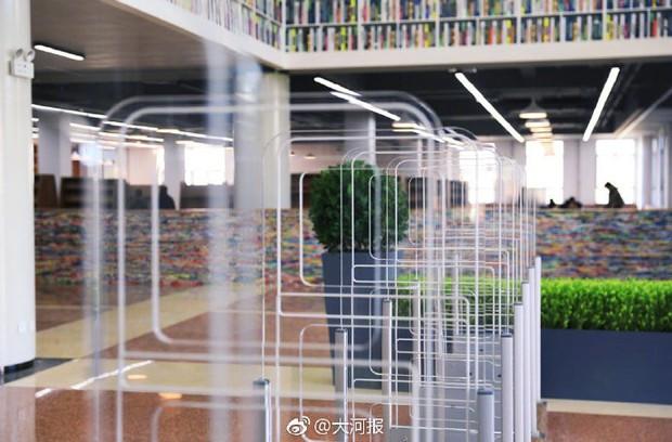 Choáng ngợp thư viện trường ĐH 57 tỷ, rộng 20.000 m2 được xây theo phong cách thuỷ cung - Ảnh 7.