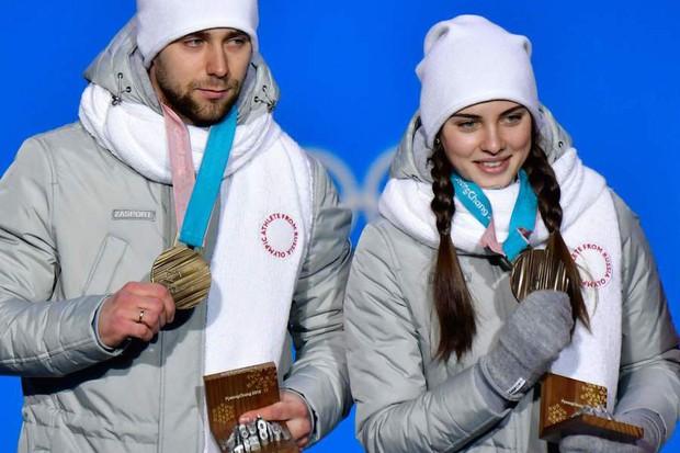 VĐV Nga bị kiểm tra doping vì... vợ quá đẹp? - Ảnh 1.
