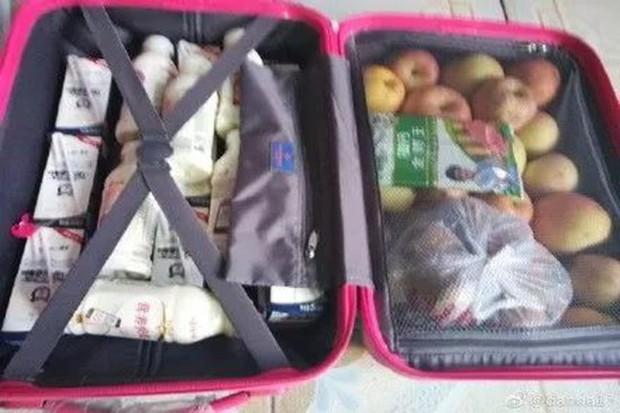 Trở về thành phố sau Tết, những người con xa quê còn mang theo nhiều món ăn nặng trĩu tình yêu của cha mẹ - Ảnh 13.