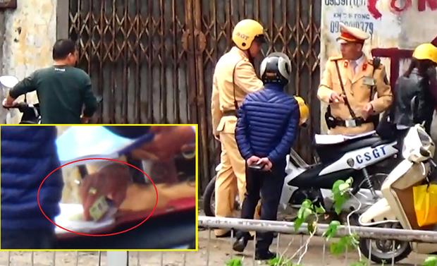 Công an Hà Nội xác nhận có cán bộ, chiến sỹ CSGT liên quan đến clip nghi mãi lộ - Ảnh 2.
