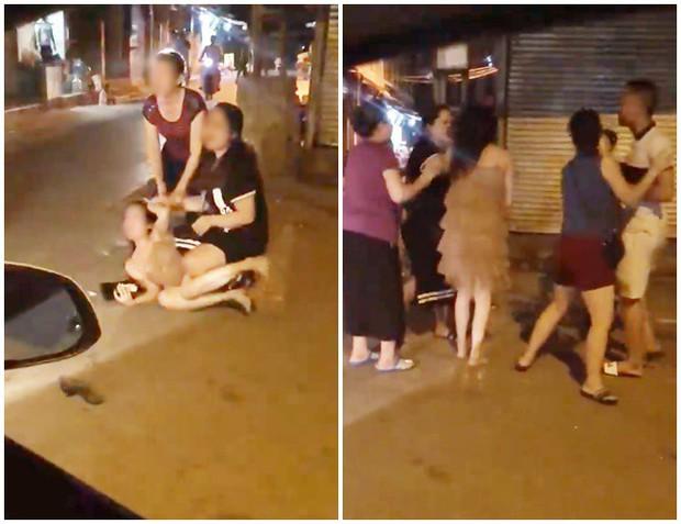 Xôn xao clip cô gái trẻ bị túm tóc đánh ghen ngay trên phố Hà Nội - Ảnh 1.