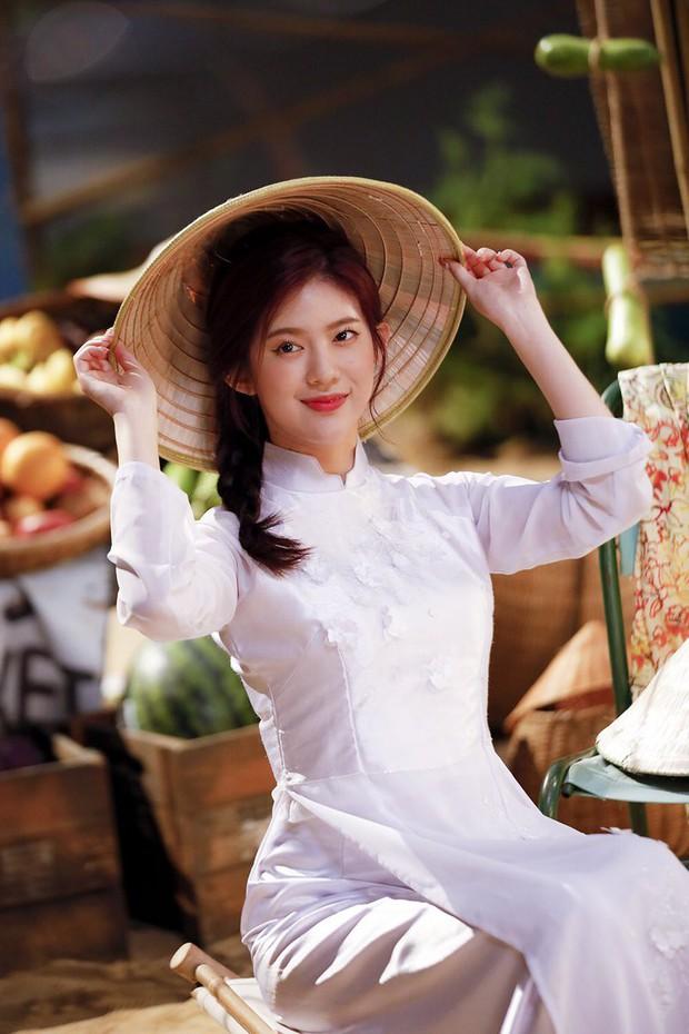 MOMOLAND mặc áo dài, đội nón lá trong MV mới: Có khác gì con gái Việt Nam? - Ảnh 3.