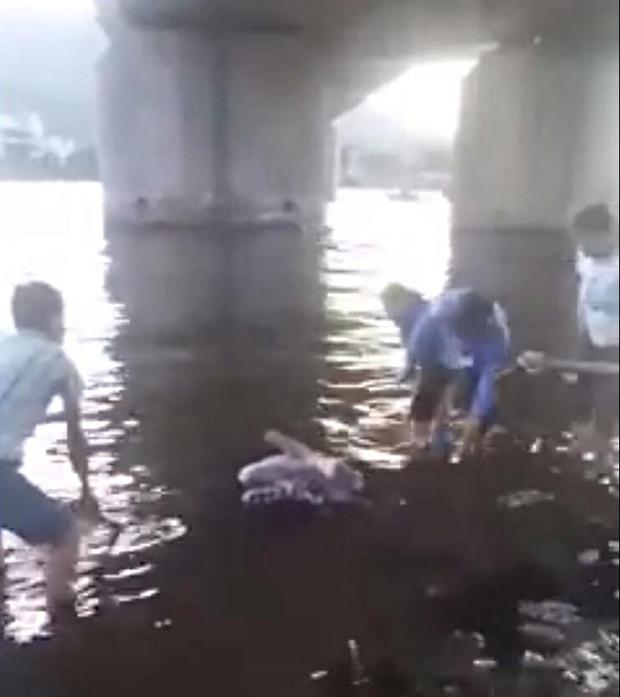 Vụ thi thể bị trói chân tay nổi trên sông ở Đà Nẵng: Nạn nhân làm nghề cho vay tiền - Ảnh 1.