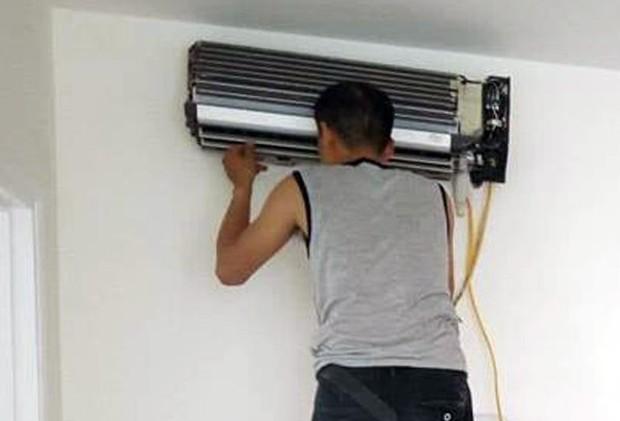 Hà Nội: Điều hòa dở chứng hàng loạt, thợ lắp đặt và bảo dưỡng làm xuyên đêm ngày nóng đỉnh điểm - Ảnh 1.