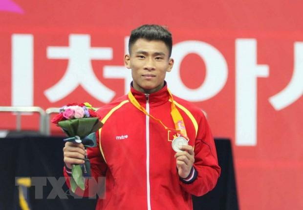 Việt Nam giành HC vàng đầu tiên tại ASIAD 2018 - Ảnh 3.