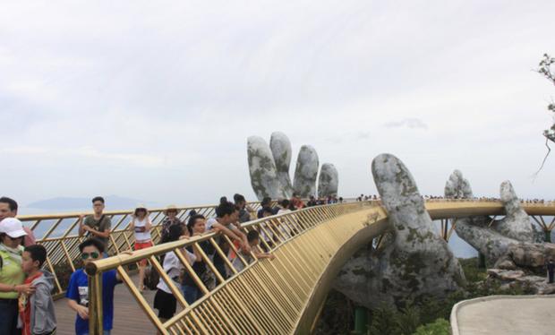 Cầu Vàng ở Đà Nẵng lọt top 100 điểm đến tuyệt vời nhất thế giới - Ảnh 2.