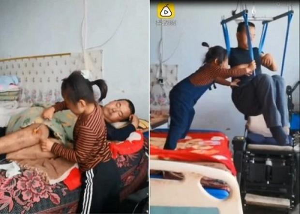 Xúc động hình ảnh bé gái 6 tuổi một mình chăm sóc cha tàn tật - Ảnh 1.