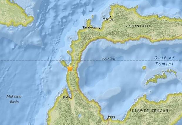 Hiện trường tan hoang sau trận động đất, sóng thần ở Indonesia - Ảnh 11.