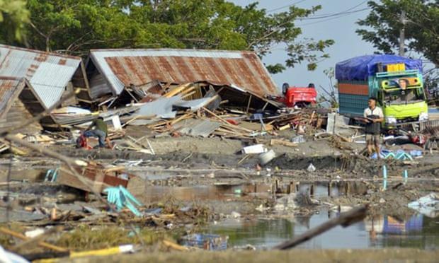 Hiện trường tan hoang sau trận động đất, sóng thần ở Indonesia - Ảnh 7.