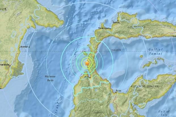 Hiện trường tan hoang sau trận động đất, sóng thần ở Indonesia - Ảnh 10.