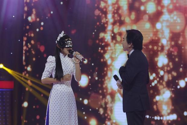 Con gái nuôi của Phi Nhung gây bất ngờ khi đeo mặt nạ thi Giọng ải giọng ai - Ảnh 5.