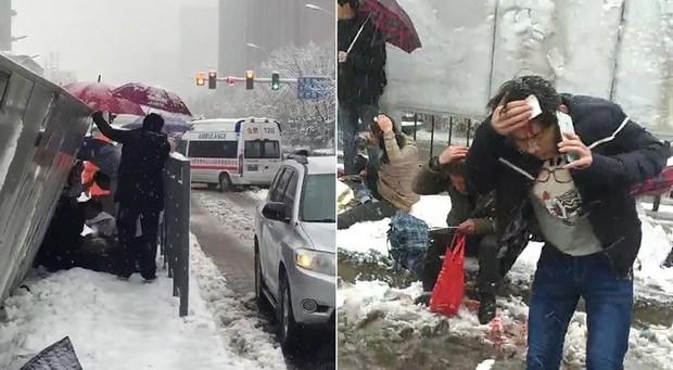 Mưa tuyết, giá lạnh tràn xuống Trung Quốc: Sinh viên cầm ô, xếp hàng lên lớp - Ảnh 4.