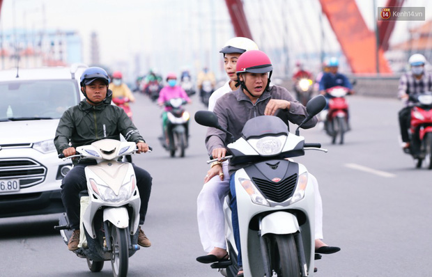 Người Hà Nội, Sài Gòn co ro trong ngày đầu đi làm sau kỳ nghỉ Tết Dương lịch 2019 - Ảnh 17.