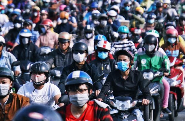 Ngộp thở với hình ảnh kẹt xe không lối thoát trên đường vào trung tâm Sài Gòn những ngày gần Tết - Ảnh 5.