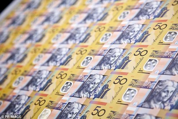 Một nhóm người ăn chay phản đối Ngân hàng Dự trữ Úc vì dùng mỡ bò để in tiền - Ảnh 2.