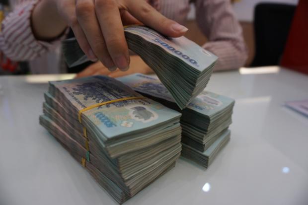 Choáng với mức thưởng Tết khủng của nhân viên ngân hàng, có người được thưởng đến 9 tháng lương - Ảnh 2.