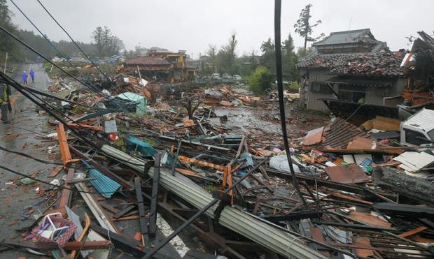 Những hình ảnh thể hiện sức tàn phá kinh khủng của siêu bão Hagibis khi nó còn chưa chính thức đổ bộ vào Nhật Bản - Ảnh 12.
