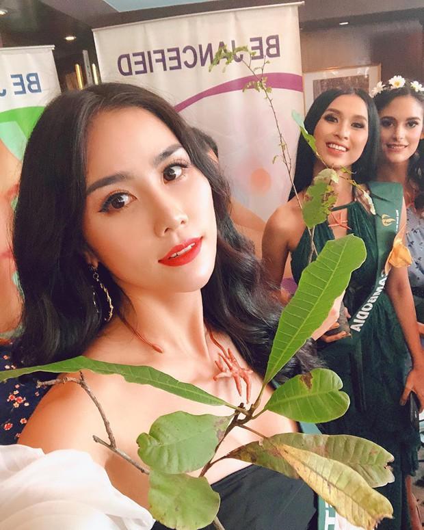 Đại diện Việt Nam ghi điểm với hành động đẹp tại Miss Earth: Cho thí sinh da màu không có trang phục mượn 2 bộ váy dạ hội! - Ảnh 6.