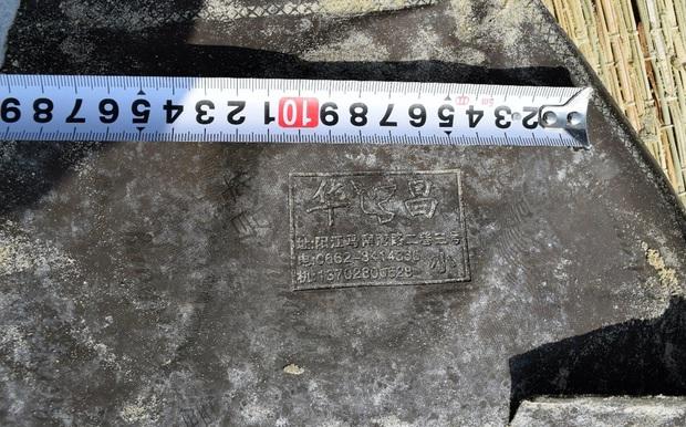 Vụ cô gái mất đầu trôi vào bãi biển ở Quảng Nam: Thêm thông tin về dòng chữ Trung Quốc trên bộ quần áo bảo hộ của nạn nhân - Ảnh 2.