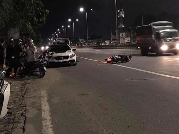 Đang kiểm tra xe ô tô, Cảnh sát giao thông bị xe máy tông mạnh từ phía sau - Ảnh 1.
