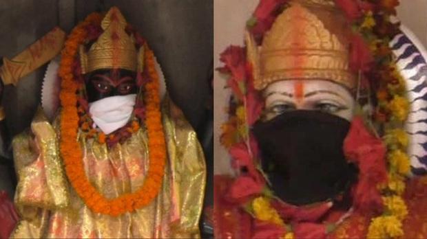 Người dân Ấn Độ đeo khẩu trang cho tượng thần để tránh không khí ô nhiễm - Ảnh 1.