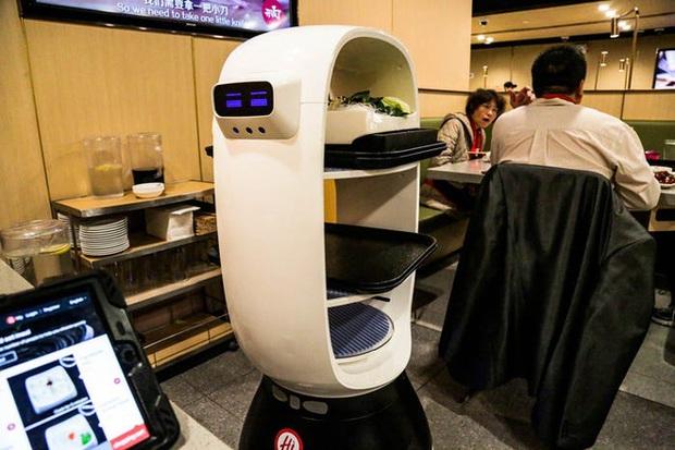 Độc đáo chuỗi nhà hàng lẩu Trung Quốc có robot phục vụ khách hàng FA, kiêm luôn làm móng miễn phí - Ảnh 12.