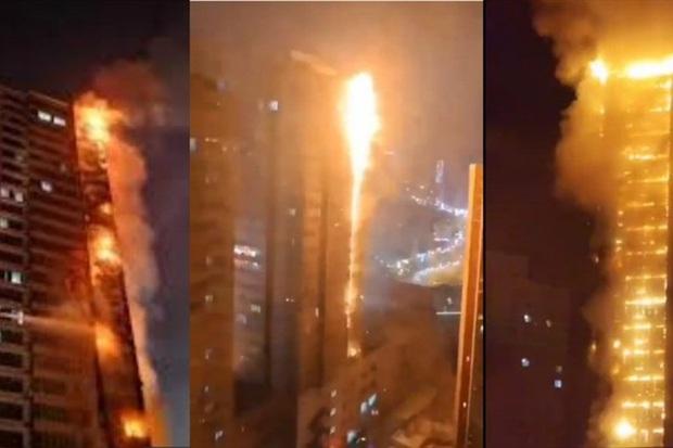 Tòa nhà 25 tầng ở Trung Quốc cháy lớn trong đêm - Ảnh 1.