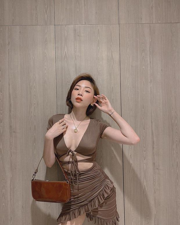 Street style sao Việt: Quỳnh Nga kín như bưng, đối lập với Tóc Tiên sexy ná thở - Ảnh 1.