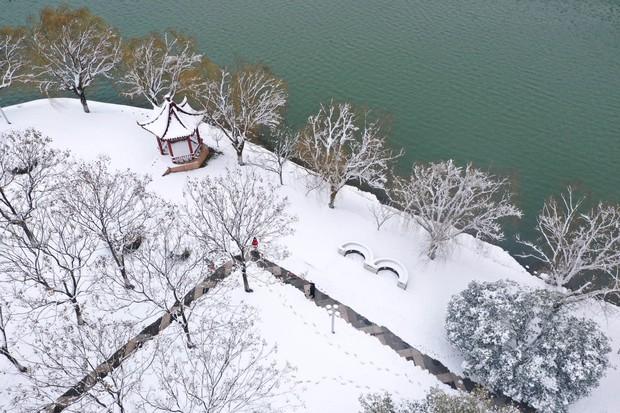 Vẻ đẹp trong trẻo của tuyết mùa xuân ở Trung Quốc khiến nhiều tín đồ du lịch cuồng chân dù đã hết Tết - Ảnh 11.