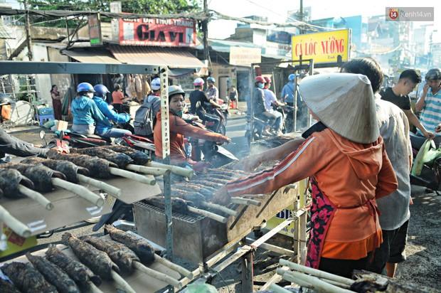 Huy động cả dòng họ chế biến hàng ngàn con cá lóc bán trong ngày vía Thần tài ở Sài Gòn - Ảnh 11.