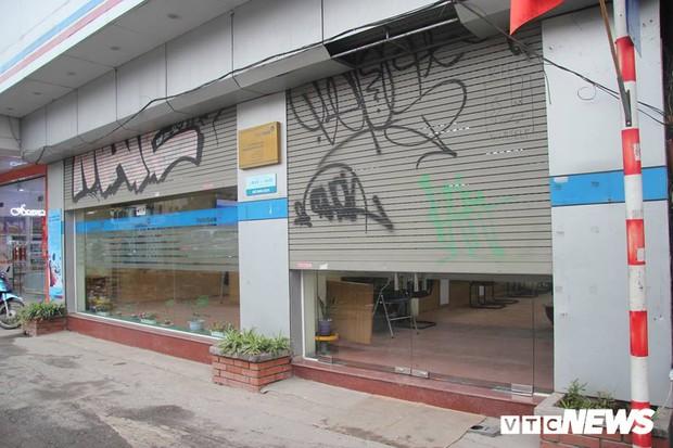 Truy tìm những kẻ vẽ bậy lên hàng loạt ngôi nhà trên phố Thủ đô - Ảnh 7.
