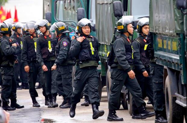 Hình ảnh ông Kim Jong Un lần đầu xuất hiện tại Việt Nam qua ống kính phóng viên quốc tế - Ảnh 9.