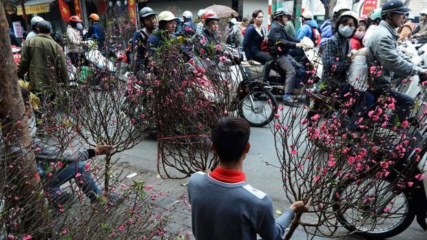 CNN bầu chọn 12 hình ảnh Tết Nguyên Đán trên khắp thế giới, Việt Nam góp mặt với khung cảnh giản dị thân quen - Ảnh 10.