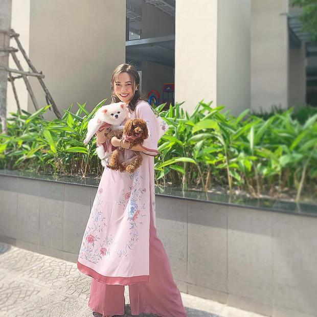 Đã thành thói quen, cứ mùng 1 Tết là từ sao tới hot girl Việt lại diện áo dài tưng bừng - Ảnh 8.
