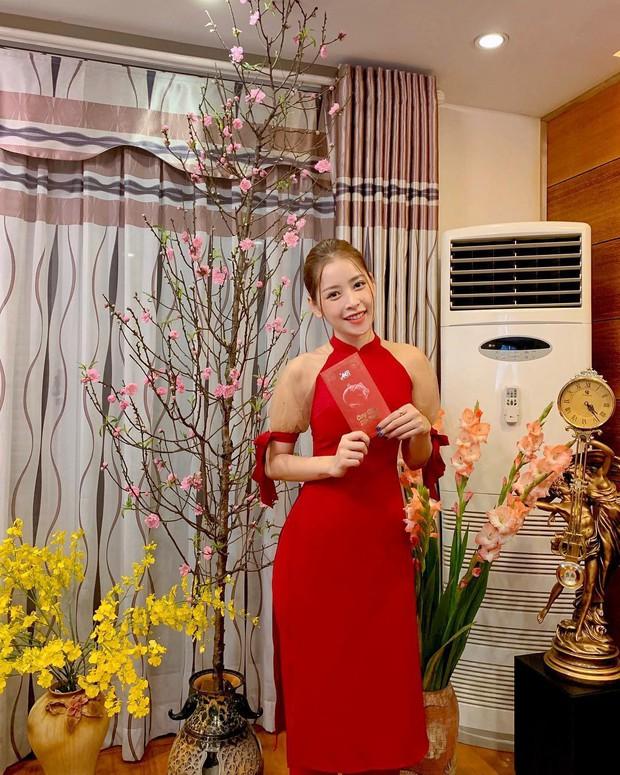 Đã thành thói quen, cứ mùng 1 Tết là từ sao tới hot girl Việt lại diện áo dài tưng bừng - Ảnh 1.